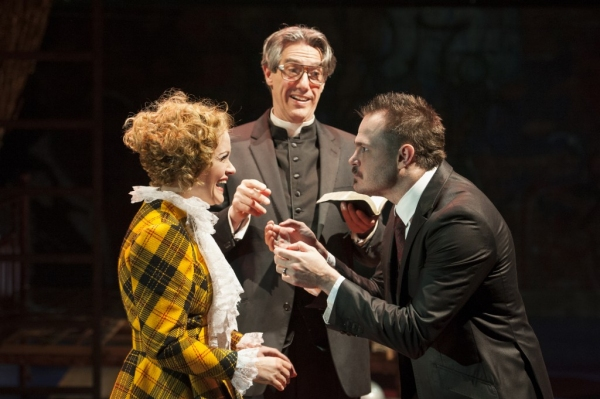 Reverend Kimball (Thomas Adrian Simpson, center) oversees the marriage of Polly Peachum (Erin Driscoll) and Macheath (Mitchell Jarvis)