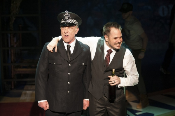 Tiger Brown (John Leslie Wolfe) and Macheath (Mitchell Jarvis) relive their military days in ''The Cannon Song''