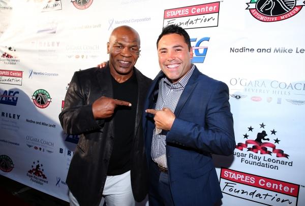 Former professional boxers Mike Tyson and Oscar de la Hoya