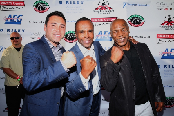 Former professional boxers Oscar de la Hoya, Sugar Ray Leonard and Mike Tyson