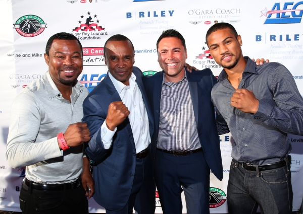 Former professional boxers Shane Mosely, Sugar Ray Leonard, Oscar de la Hoya and current boxer Shane Mosely Jr.