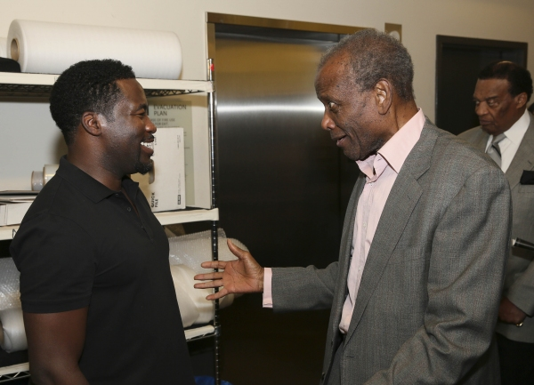 Daniel Beaty is congratulated by actor Sidney Poitier