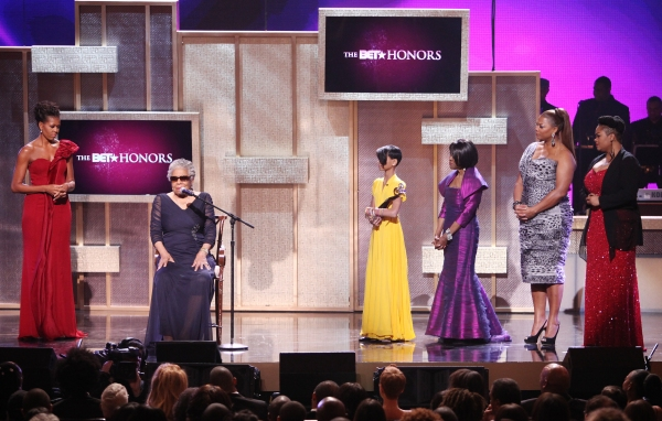 Michelle Obama with Maya Angelou, Willow Smith, Cicely Tyson, Queen Latifah and Jill Scott.onstage during the BET Honors 2012 at the Warner Theatre on January 14, 2012 in Washington, DC.