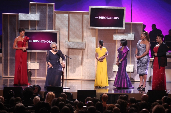 Michelle Obama with Maya Angelou, Willow Smith, Cicely Tyson, Queen Latifah and Jill Scott onstage during the BET Honors 2012 at the Warner Theatre on January 14, 2012 in Washington, DC.