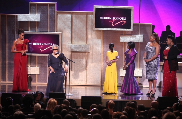 Michelle Obama with Maya Angelou, Willow Smith, Cicely Tyson, Queen Latifah and Jill Scott on stage during the BET Honors 2012 at the Warner Theatre on January 14, 2012 in Washington, DC.
