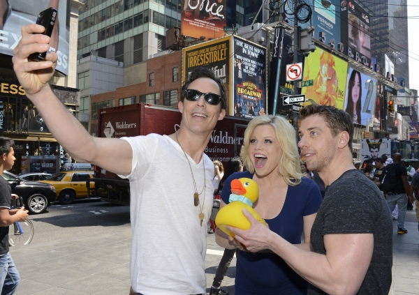 LUCKY DUCK - Christian Borle, Megan Hilty and Tom Cavanagh who voice the lead characters in ''Lucky Duck,'' the first Disney Junior Original Movie, treated one lucky duck to a guided tour of New York City, 6/3/14, to celebrate the premiere of their new mo