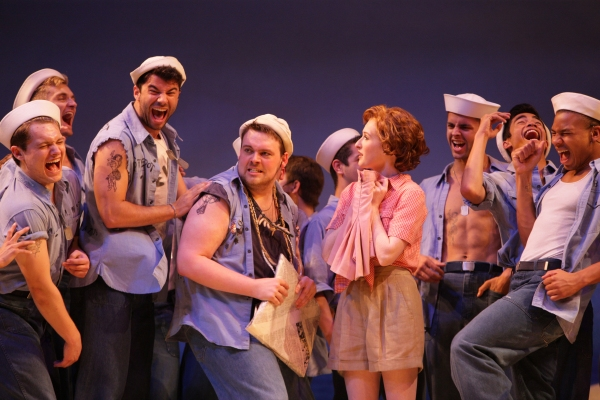 Nellie (Erin Mackey) gets her laundry from Billis (J. Bailey Burcham) and the island  Photo