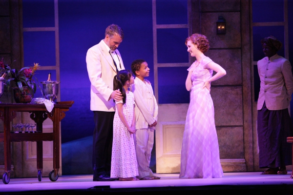 Emile de Becque (Mike McGowan) introduces his children Ngana (Sage Belen Goco) and Jerome (Camdin  Hardyway) to Nellie Forbush (Erin Mackey)