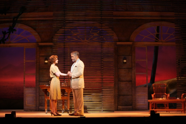 "Emile de Becque (Mike McGowan) serenades Nellie Forbush (Erin Mackey) with ""Some Enchanted Evening"""