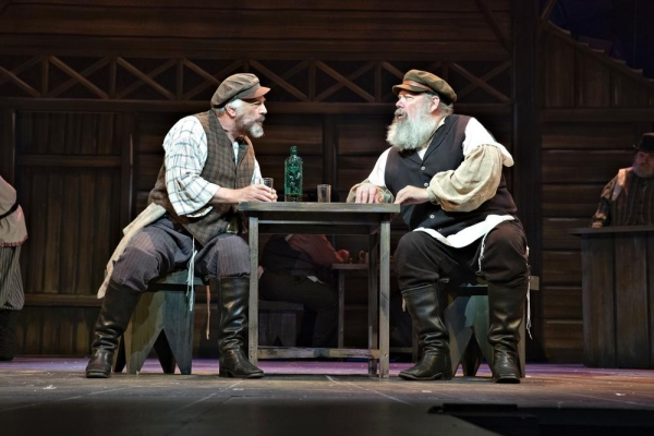 Joe Vincent, left, as Tevye the Dairyman, and John Ahlin as Lazar Wolf, the butcher, begin their negotiations.