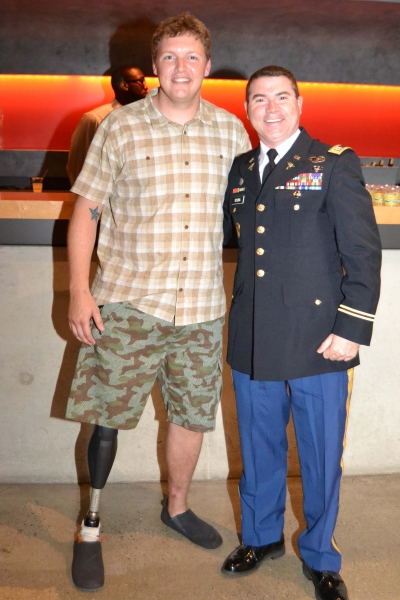 (L to R) Company member Paul Hurley and U.S. Army Captain Steve Scuba at the opening night celebration for Healing Wars at Arena Stage at the Mead Center for American Theater June 12, 2014.