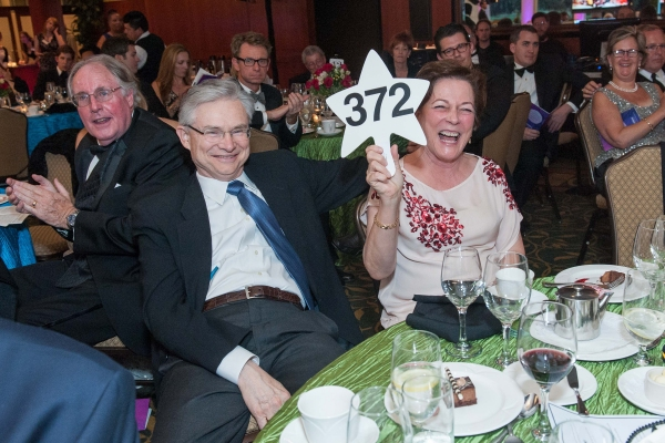 Craig Dauchy and Sue Crawford put in a winning bid during the live auction