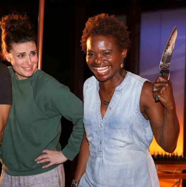 Idina Menzel and LaChanze with the ensemble cast attend the  ''If/Then'' 100th performance celebration backstage at the Richard Rodgers Theatre on June 25, 2014 in New York City.