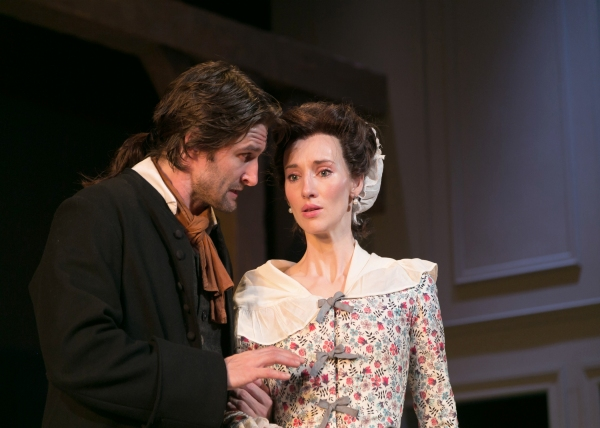 Richard Dudgeon (James Knight) counsels Judith Anderson (Elizabeth A. Davis) as the military tensions rise in the town.
