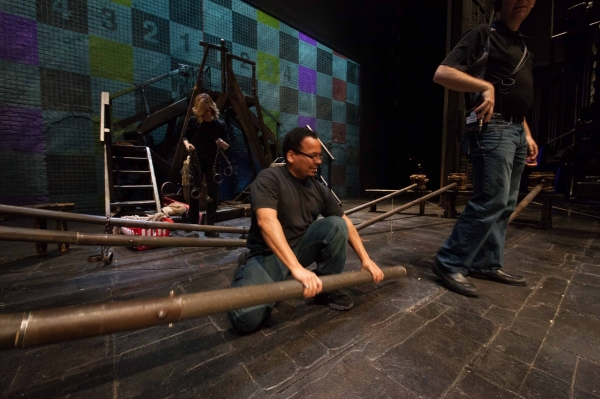 Left to Right – House Props Head Heidi Brown, Production Properties Head Edward De Jesus, Head Carpenter Chad Woerner ready the set for the opening number. Photo by Max Gordon Photography.
