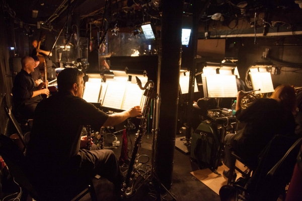 The LES MIZ orchestra getting warmed up for the performance. Photo by Max Gordon Photography.