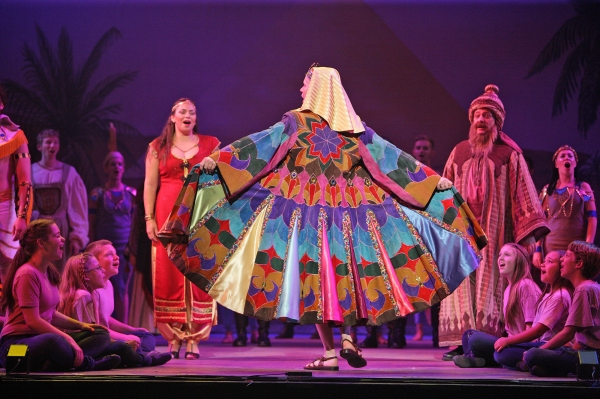 Joseph's suede coat was designed by Shawn-Adrian DeCou, and is here worn by Joseph (Ian Patrick Gibb) and admired by the Narrator (Darcie Roberts) and Jacob (Nicholas F. Saverine).