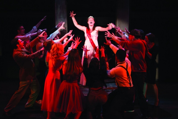 Emily Zickler as Carrie White and the ensemble