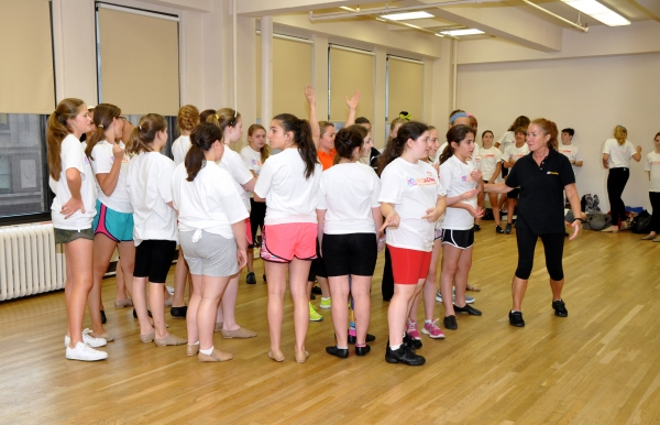 Sue Delano teaching a dance routine to the Camp Broadway Kids Photo