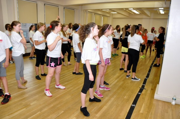 Sue Delano teaching a routine to the Camp Broadway Kids Photo