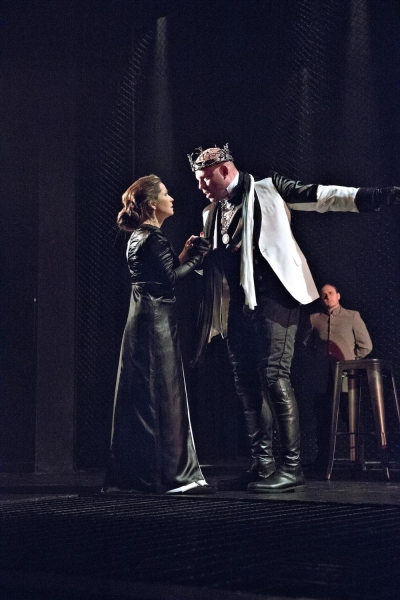 Macbeth, played by Ian Bedford, center, tries to convince Lady Macbeth, Susan Riley Stevens, that he has seen the ghost of his former comrade in the Pennsylvania Shakespeare Festival production of Macbeth, running on the Main Stage through August 3. Also