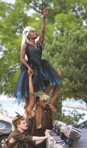 Fairy Queen Titania (Lanise Antoine Shelley) ascends to the stage, supported by her fairy attendants Michael Finley and Justin Cornwell