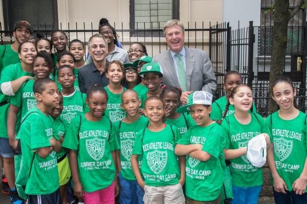 NYC Youngsters gather with new PAL Board Member Tony Danza and PAL President John Osborn at the opening of the 2014 Summer Playstreets Program.