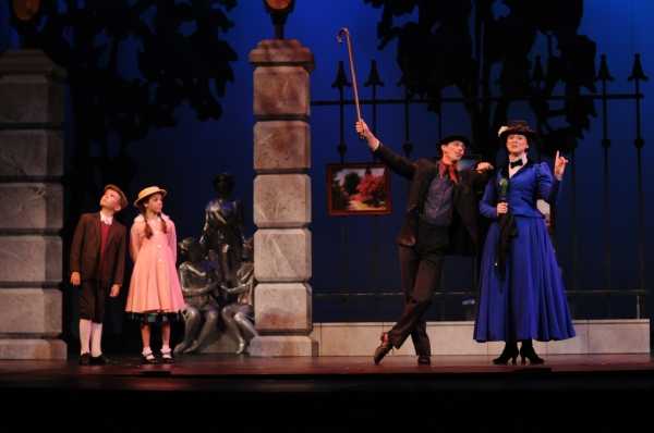 Bert (Patrick Clealand Rosé) and Mary Poppins (Catharine Kay) with Jane (Ella Schnoor) and Michael (Tyson Francis) in the Park