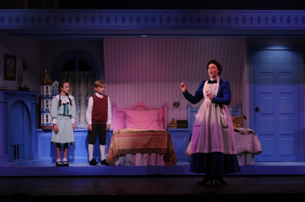 Mary Poppins (Catharine Kay) with Jane (Ella Schnoor) and Michael (Tyson Francis) in the nursery
