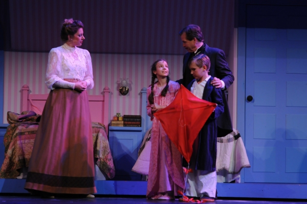 The Banks Family With Kite (Jack Rowles as George, Tara Michelle Gesling as Winifred, Ella Schnoor as Jane, and Tyson Francis as Michael)