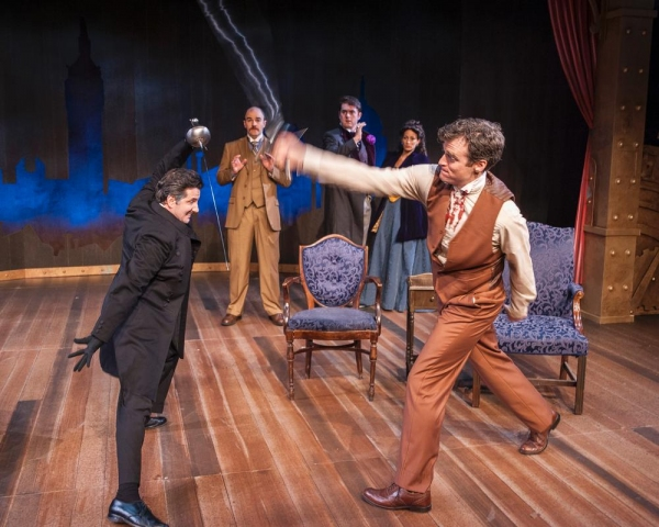 David Gautschy as Professor Moriarty and Nate Washburn as Sherlock Holmes with (in the background) Joel Stigliano as Doctor Waston, Jack Corcoran as Oscar Wilde and Danielle Shimshoni as Lillie Langtry