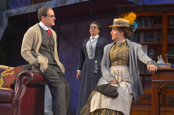 Anthony Fusco as Henry Higgins, Catherine Castellanos as Mrs. Pearce, and Irene Lucio as Eliza Doolittle