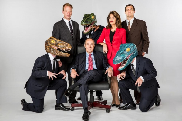 Back row L-R: Matthew Pyle as Jeffrey Skilling, Lamar Brown as Raptor, Connie Lee as Claudia Roe, Chris Shonka as Andy Fastow; Front row L-R: Jon Roberson as Raptor, Paul Schneider as Ken Lay, Steve Hartman as Raptor