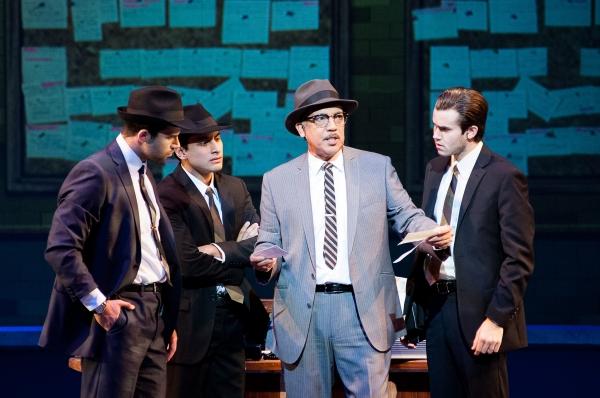 FBI agent Carl Hanratty (Thom Sesma) gives advice to his men (Michael Graceffa, Robert Ariza, and Kevin Clay).