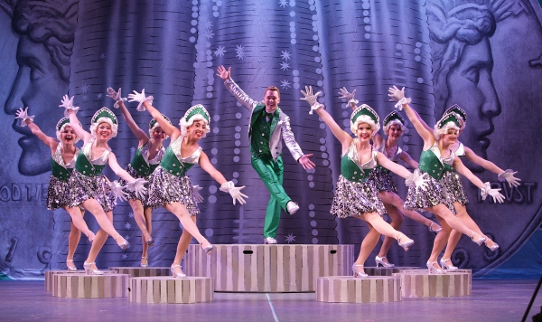 "Billy Lawlor (Shonn Wiley) leads the tapping ladies in ""We're in the Money''"