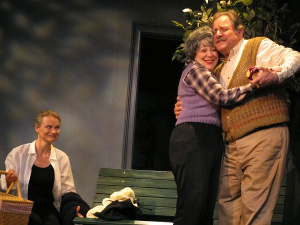 Alexis (Celia Schaefer) imagines picknicking with her parents (Gillien Goll and Bob Ari)