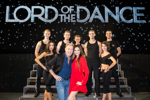 Back: Matt Smith, Aimee Black, James Keegan, Alice Upcott, Morgan Comer, Caroline Gray, Tom Cunningham; Front: Michael Flatley and Nadine Coyle