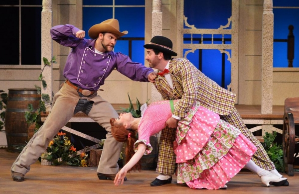 A jealous Will Parker (Daniel S. Hines), left, prepares to throw a punch when he finds his sweetheart, Ado Annie (Timmy Hays) in the arms of the peddler Ali Hackem (Brian Sutow), who is giving her a ''Persian goodbye''