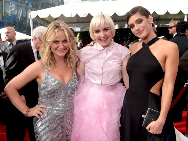 66th ANNUAL PRIMETIME EMMY AWARDS -- Pictured: (l-r) Actresses Amy Poehler, Lena Dunham and Lizzy Caplan arrive to the 66th Annual Primetime Emmy Awards held at the Nokia Theater on August 25, 2014 -- (Photo by: Jason Kempin/NBC)