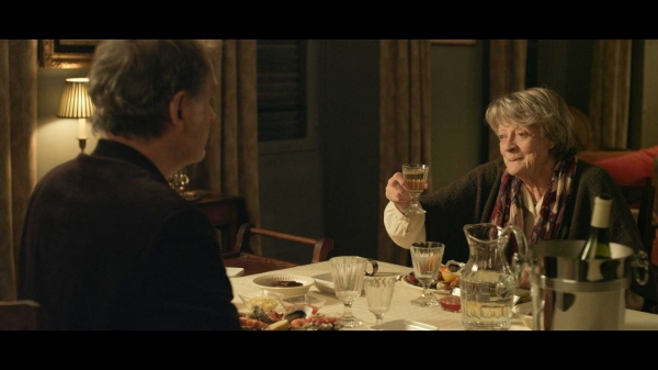 Maggie Smith as Mathilde Girard (foreground: Kevin Kline as Mathias Gold