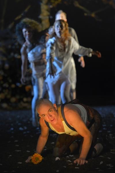Danny Scheie as Puck, Lauren English as Helena, Tristan Cunningham as Hermia, and Nicholas Pelczar as Demetrius