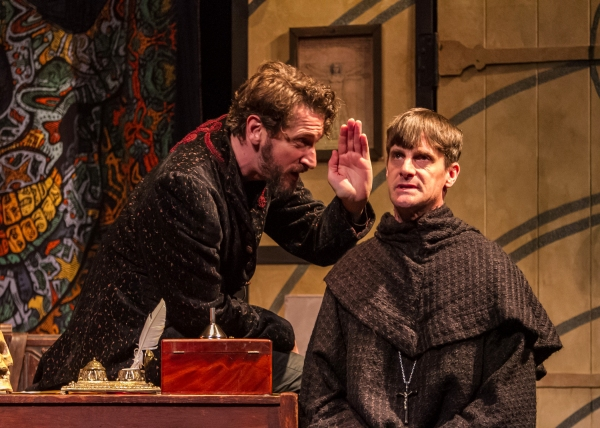 The University's two great minds�John Faustus (Anthony Marble) and Martin Luther (Mark H. Dold) debate fate and faith.