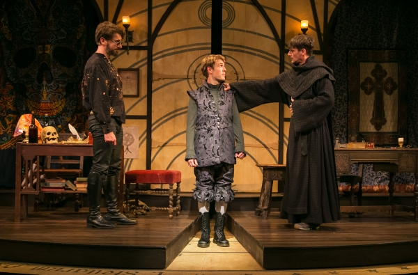 Professors John Faustus (Anthony Marble, left) and Martin Luther (Mark H. Dold, right) advise the wavering Hamlet (Jordan Coughtry, center).