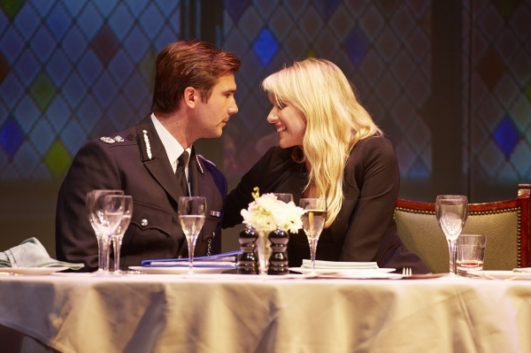 Asst. Commissioner Donald Doyle Davidson (Ben Mansfield) and Paige Britain (Lucy Punch)