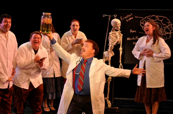 Dr. Frederick Frankenstein (R. MichaelClinscales) celebrates the brain with his medical school students. Photo by Tom Brown.