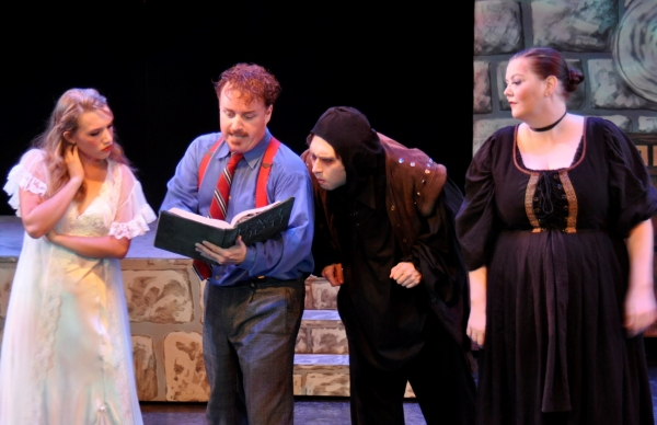 Reading grandfather's How I Did It. At right, Rebeccas Smootz as Frau Blucher. Photo by Tom Brown.