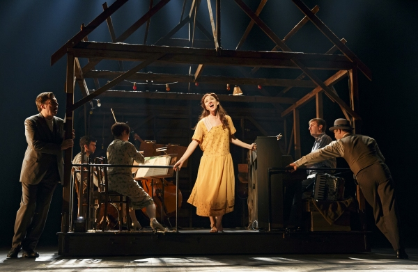 (foreground) Carmen Cusack as Alice Murphy with (from left) Scott Wakefield and Joe Jung and the orchestra