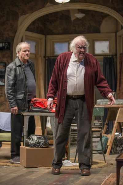 Tommy (ensemble member Francis Guinan) looks on as Maurice (M. Emmet Walsh) reminisces about his past