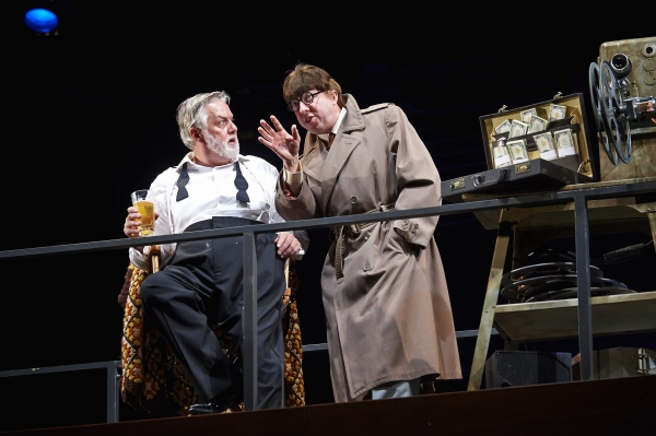 Actor Lynn Robert Berg (right, as Mr. Frank Ford in disguise) describes his plan to Aled Davies (left, as Falstaff)