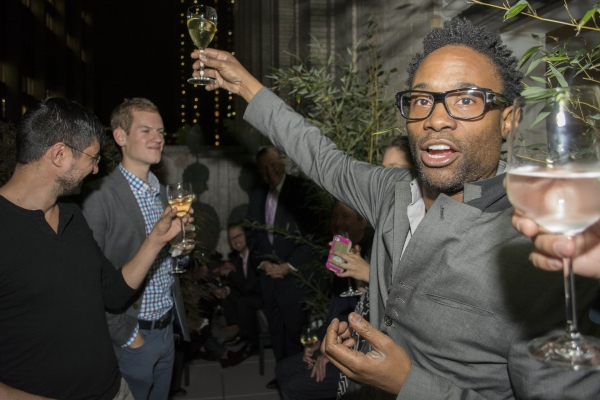 Billy Porter making a toast